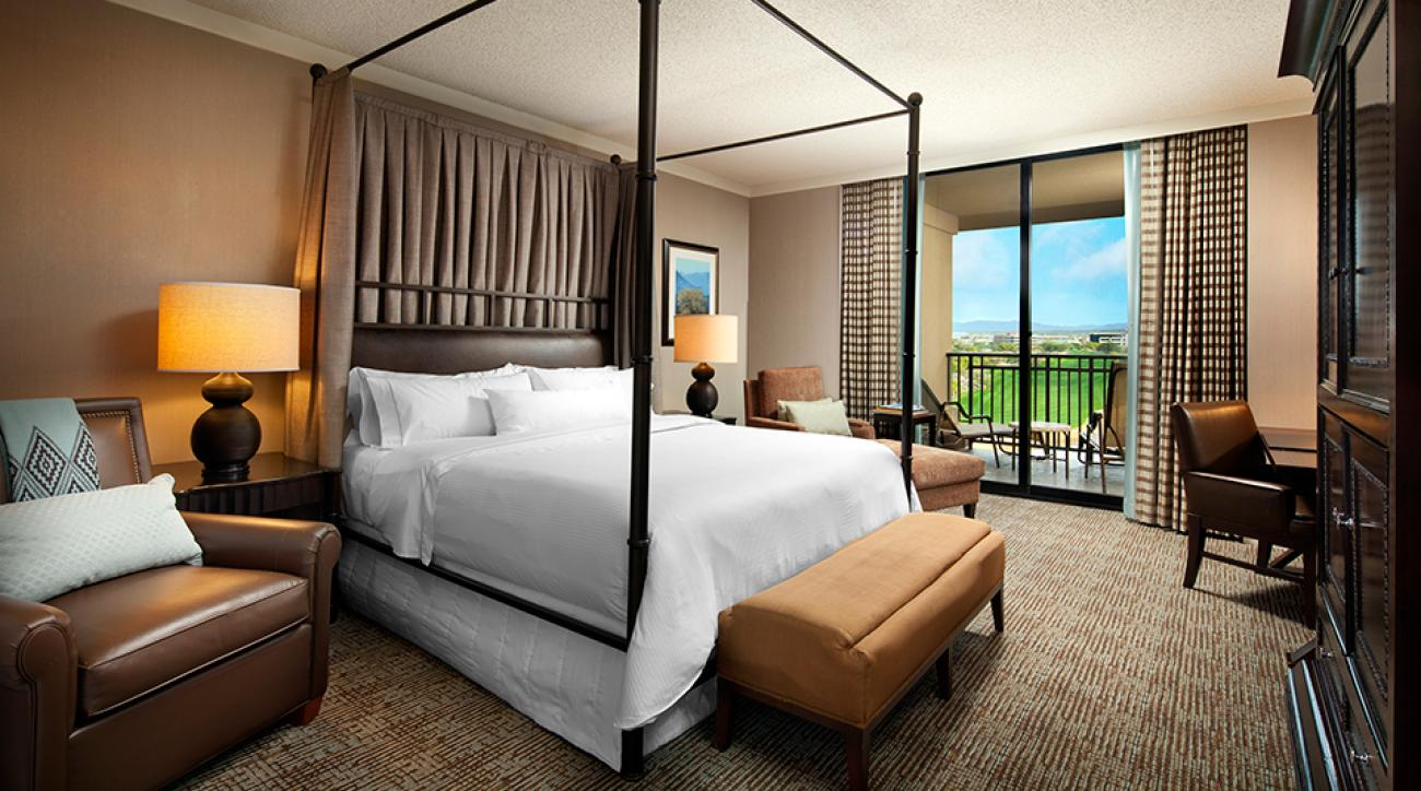 The bedroom features a private balcony with stellar views of the golf course.