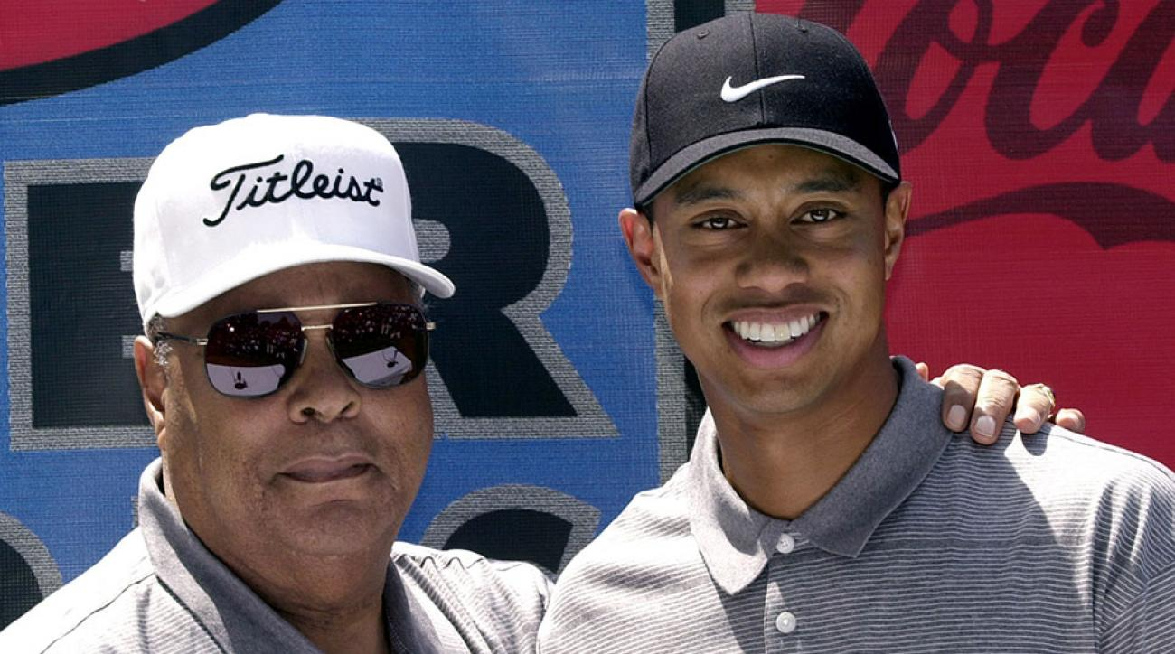 Tiger Woods and his father Earl Woods arrive at a press conference April 14, 2001 at the Coca-Cola Tiger Woods Foundation Junior Golf Clinic at the El Dorado Park Golf Course in Long Beach, CA.