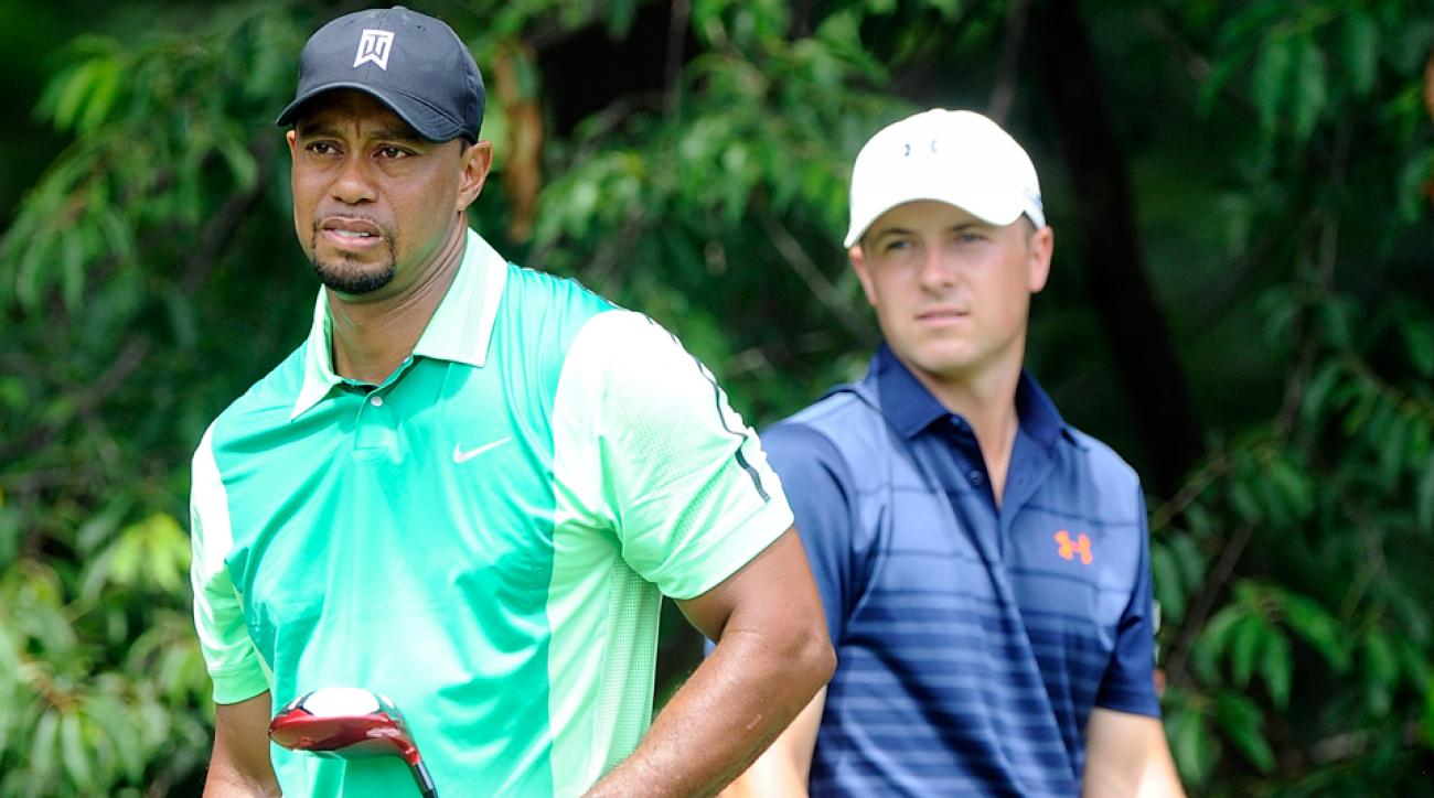 Jordan Spieth and Tiger Woods watch a shot during the Quicken Loans National at Congressional Country Club on June 26, 2014, in Bethesda, Maryland.