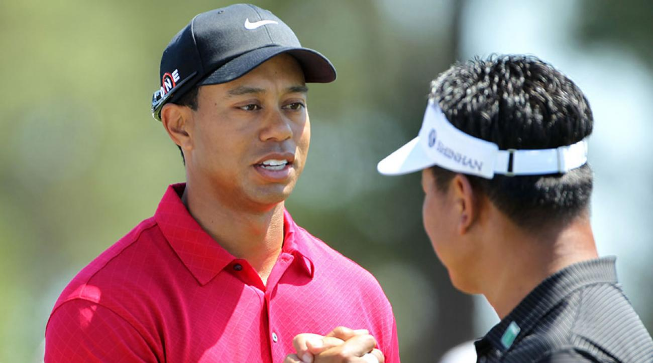 AUGUSTA, GA - APRIL 11: (L-R) Tiger Woods and K.J. Choi of South Korea shake hands before teeing off on the first hole during the final round of the 2010 Masters Tournament at Augusta National Golf Club on April 11, 2010 in Augusta, Georgia.