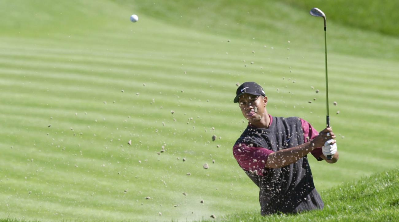 Tiger Woods hits a bunker shot at TPC Sawgrass during the final round of The Players Championship on March 26, 2001, in Ponte Vedra Beach, Florida.