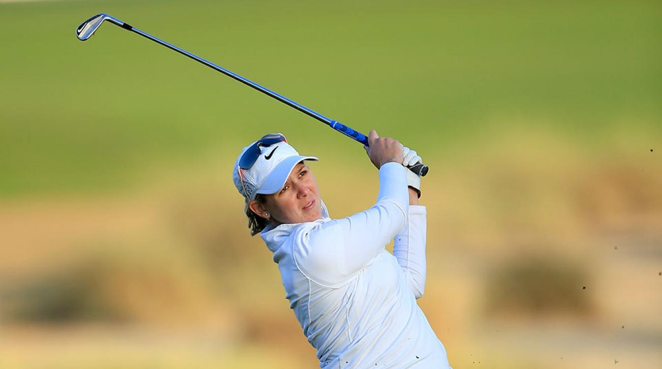 Ashleigh Simon of South Africa plays her third shot on the par 5, 10th hole during the second round of the 2015 Omega Dubai Ladies Masters on the Majlis Course at The Emirates Golf Club.