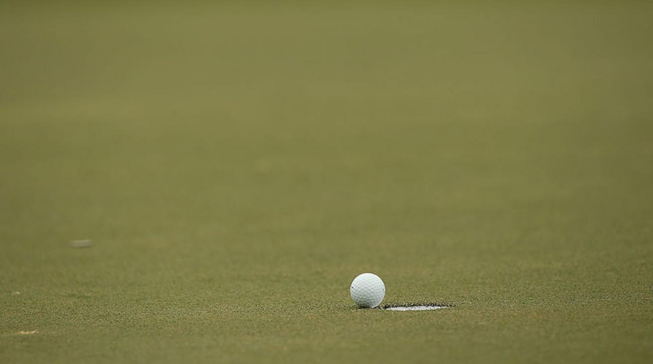 A ball rolls toward the cup on the course at the Sedgefield Country Club.