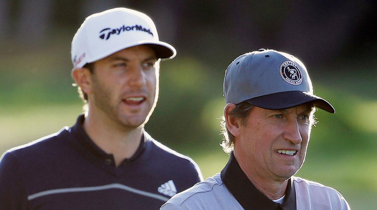 Dustin Johnson (L) waits alongside hockey legend Wayne Gretzky during the first round of the AT&T Pebble Beach National Pro-Am at Monterey Peninsula Country Club on February 12, 2015 in Pebble Beach, California.