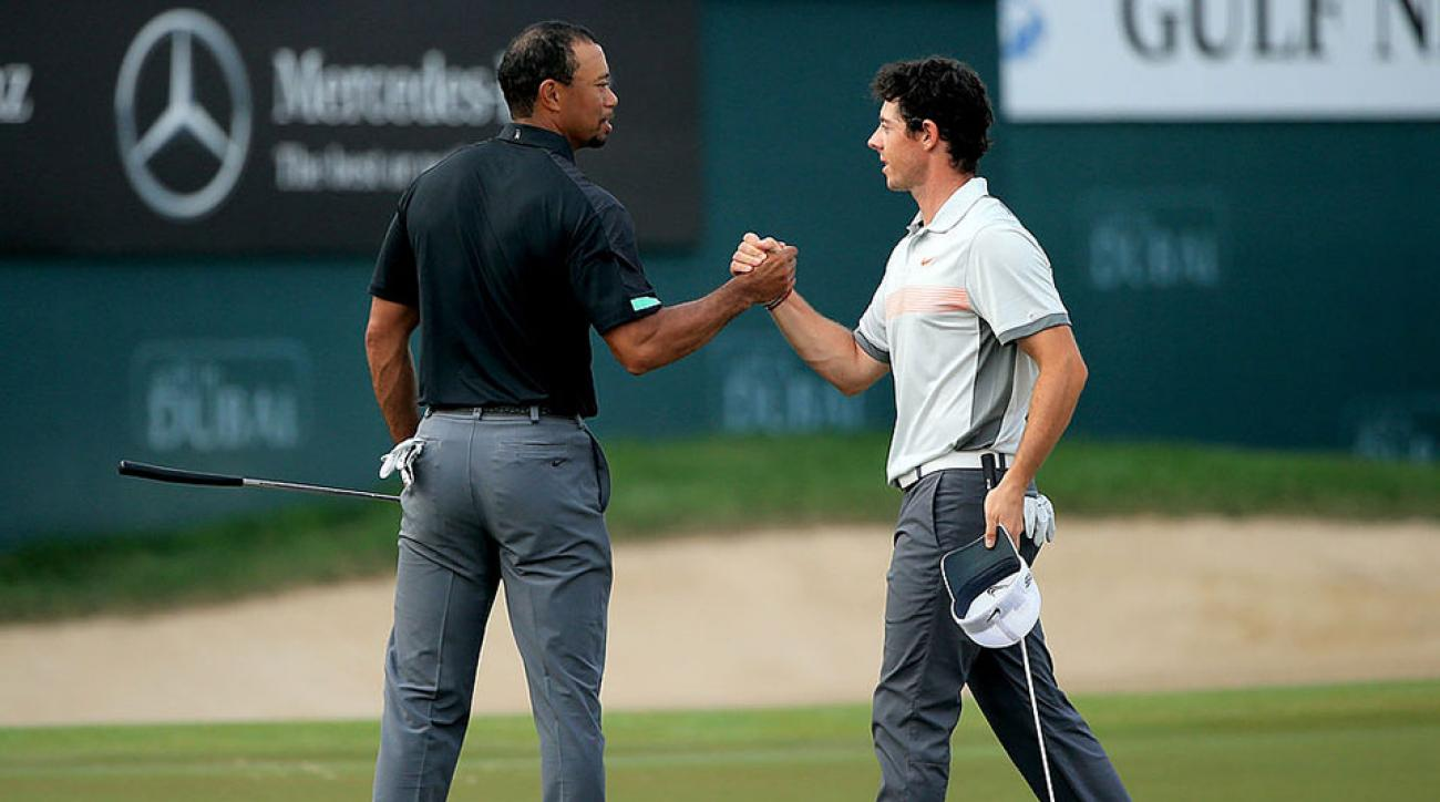 Rory McIlroy and Tiger Woods shake hands on the 18th green during the 2014 Omega Dubai Desert Classic.