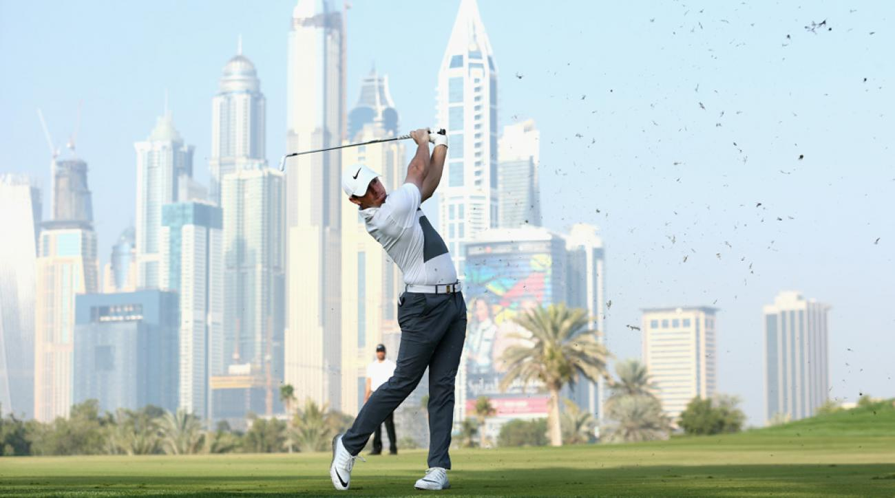 Rory McIlory plays his second shot into the 13th green during the first round of the Omega Dubai Desert Classic on the Majlis course at the Emirates Golf Club on Feb. 4, 2016, in Dubai, United Arab Emirates.