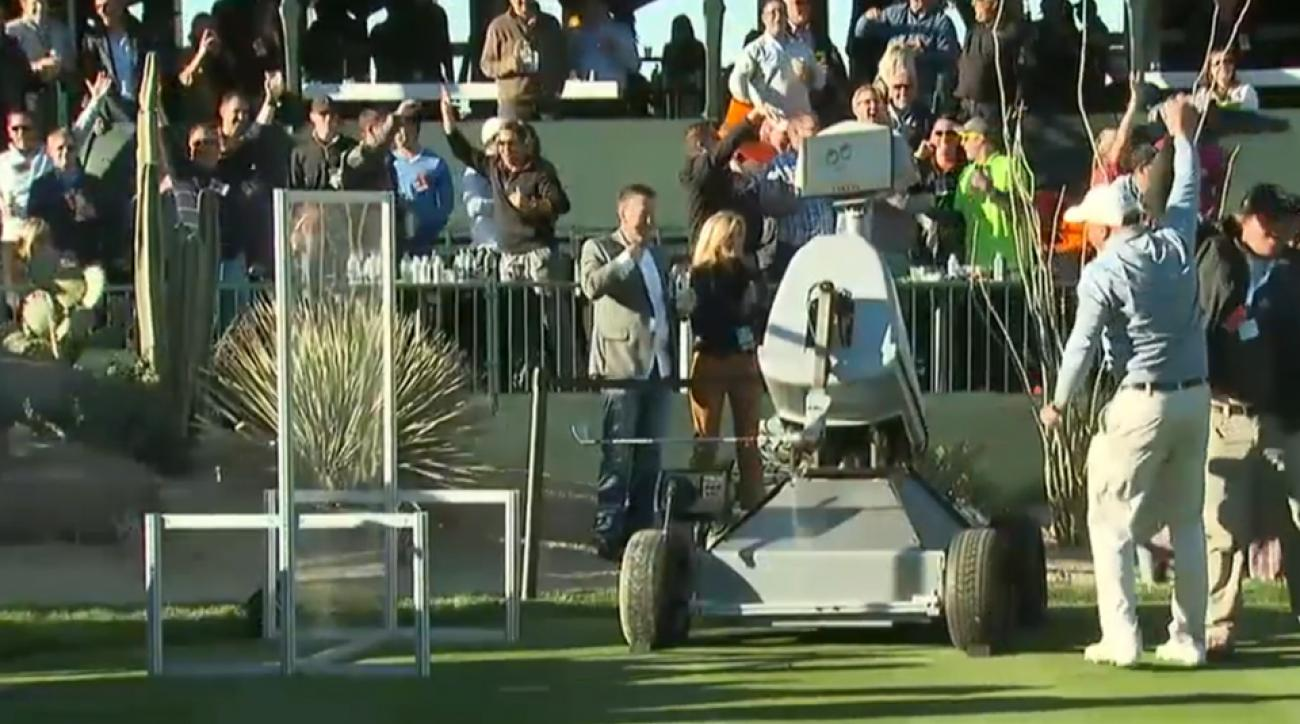 The crowd around the tee box at the 16th at TPC Scottsdale celebrates the ace made by the robot named Eldrick.