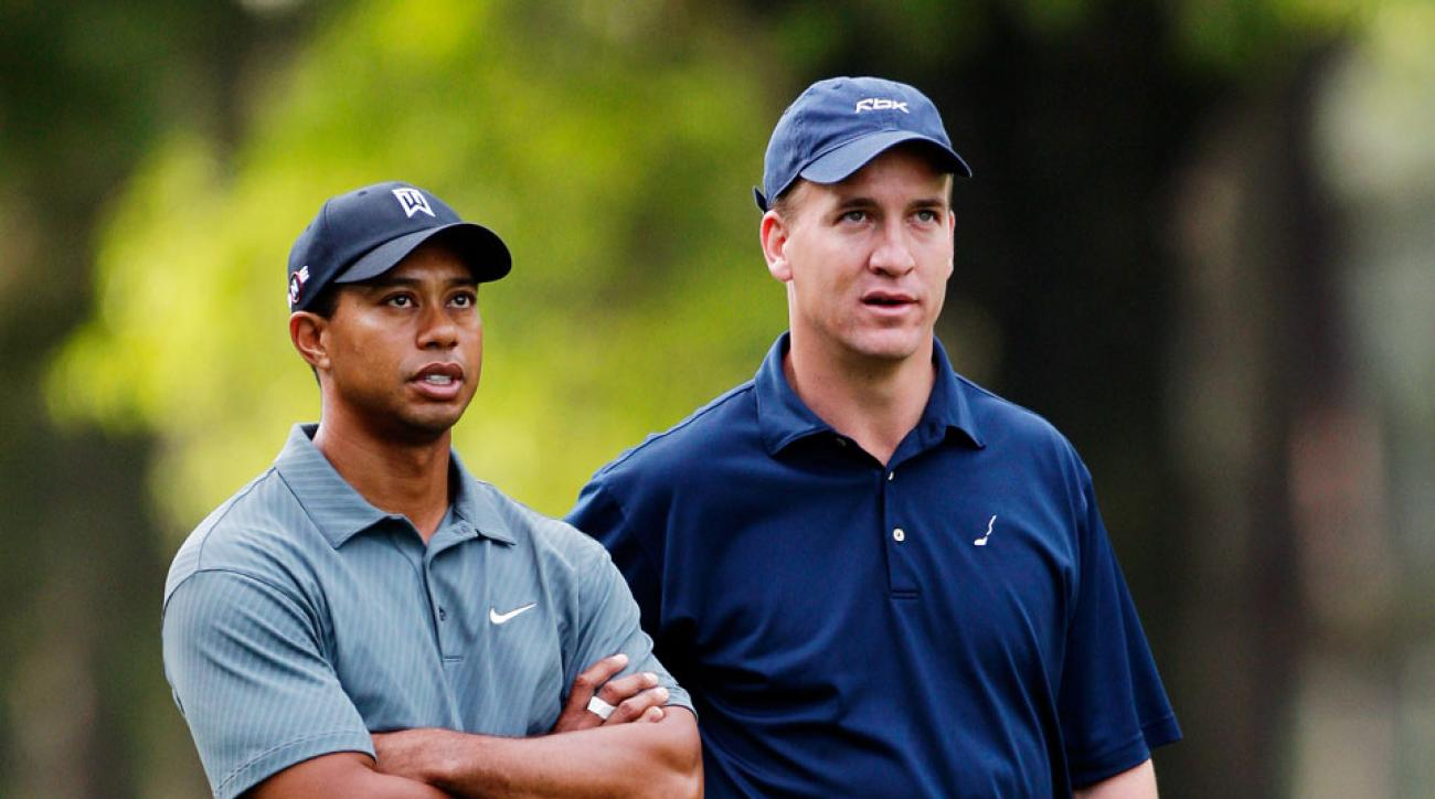 Peyton Manning with Tiger Woods during the pro-am at Quail Hollow Golf Course.