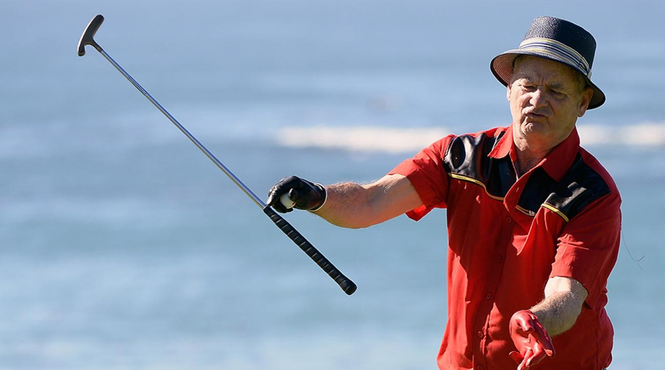 Actor Bill Murray tosses his putter on the fifth green during the third round of the AT&T Pebble Beach National Pro-Am at the Pebble Beach Golf Links on February 14, 2015 in Pebble Beach, California.