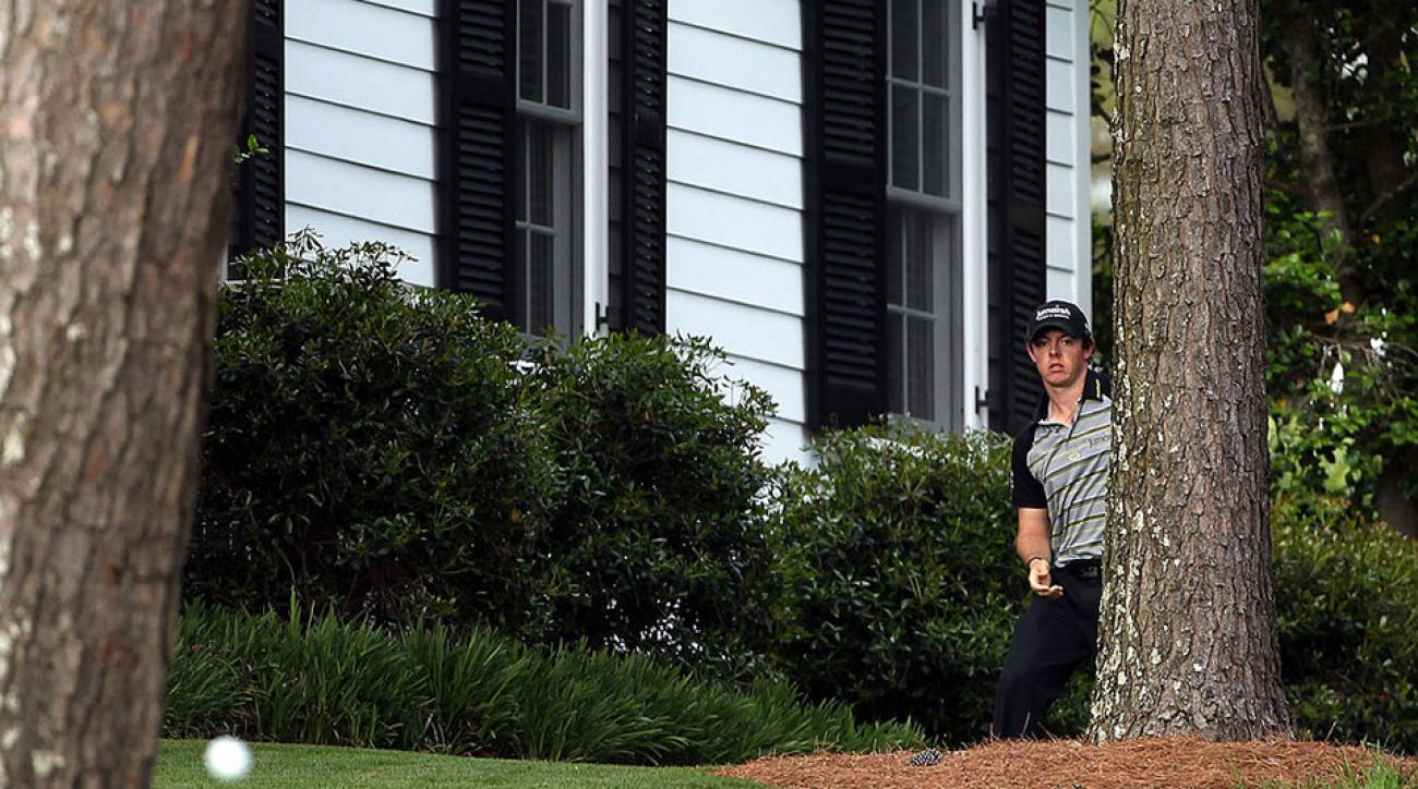 Rory McIlroy of Northern Ireland plays a shot back to the fairway on the tenth hole after an errant tee shot during the final round of the 2011 Masters Tournament.