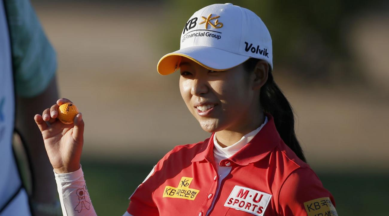 Mi Hyang Lee of South Korea waves to the crowd on the 9th hole during the first round of the JTBC Founders Cup.