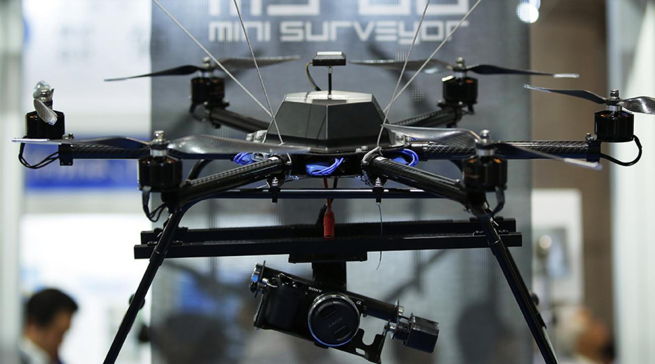 The Autonomous Control Systems Laboratory Ltd. Mini Surveyor MS-06LA multi-rotor unmanned aerial vehicle (UAV), manufactured by Kikuchi Seisakusho Co., sits on display at the International Drone Expo in Chiba, Japan, on Wednesday, May 20, 2015.