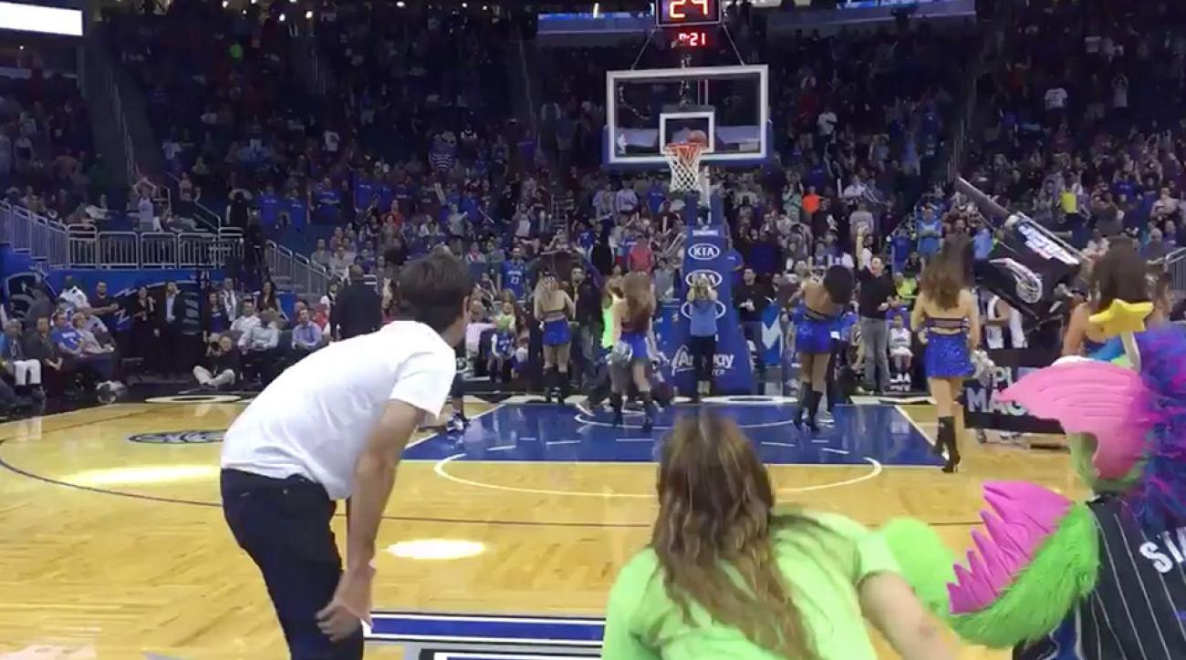 Bubba Watson from halfcourt at a NBA game.
