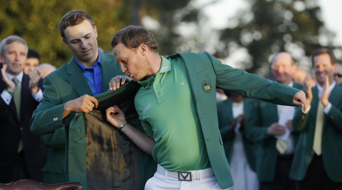 Jordan Spieth helps Danny Willett put on the green jacket after the 2016 Masters.