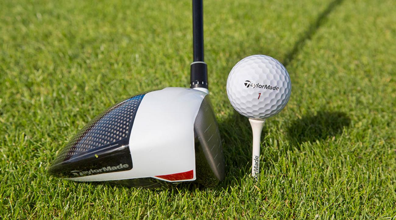 The head of an TaylorMade Driver M1 golf club rests beside a teed up TaylorMade Tour Preferred X golf ball on the golf course at the TaylorMade center of excellence, operated by Adidas AG, in Herzogenaurach, Germany.