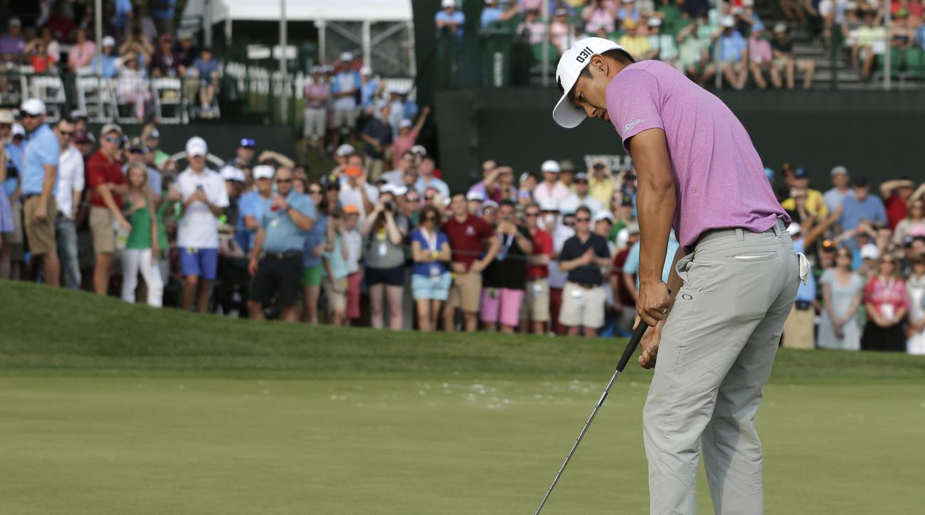 James Hahn watches his putt fall into the hole to win the Wells Fargo Championship at Quail Hollow Club in Charlotte, N.C., on May 8, 2016.