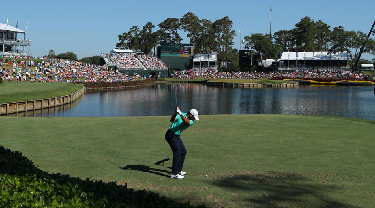 Jason Day tees off on the dangerous island-green 17th on Saturday morning.