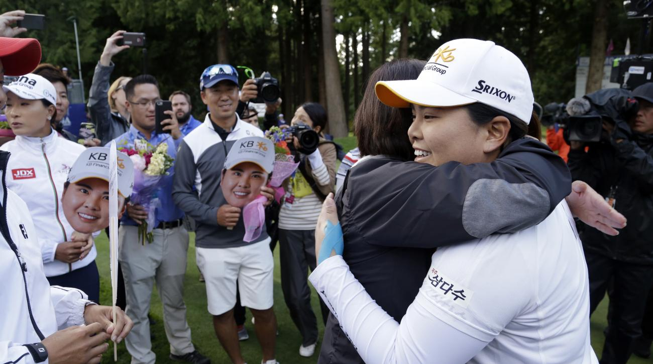 Inbee Park is embraced after finishing the first round at the Women's PGA Championship.