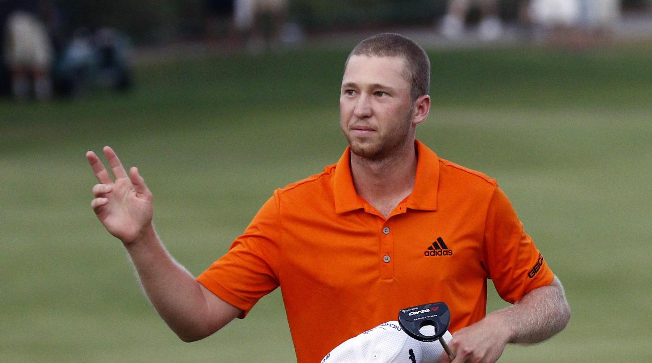 Daniel Berger waves to the crowd after winning the FedEx St. Jude Classic golf tournament, Sunday, June 12, 2016, in Memphis, Tenn. Berger won the tournament on Sunday for his first PGA Tour title, shooting a 3-under 67 to hold off Phil Mickelson, Steve
