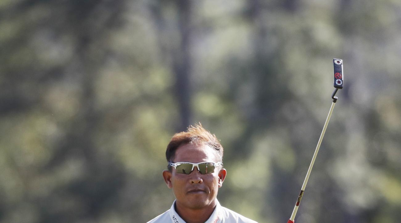 Thongchai Jaidee, of Thailand, acknowledges the gallery after putting out on the 18th hole during the second round of the Masters golf tournament Friday, April 8, 2016, in Augusta, Ga. (AP Photo/Chris