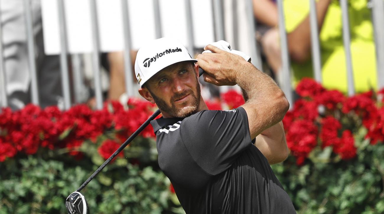 Dustin Johnson hits from the tee on the first during the third round of play at the Tour Championship golf tournament at East Lake Golf Club on Saturday, Sept. 24, 2016, in Atlanta. (AP Photo/John
