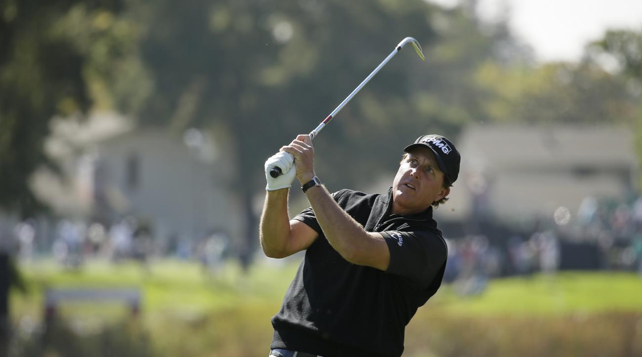 Phil Mickelson follows his approach shot from the first fairway of the Silverado Resort North Course during the pro-am event of the Safeway Open PGA golf tournament Wednesday, Oct. 12, 2016, in Napa, Calif. (AP Photo/Eric