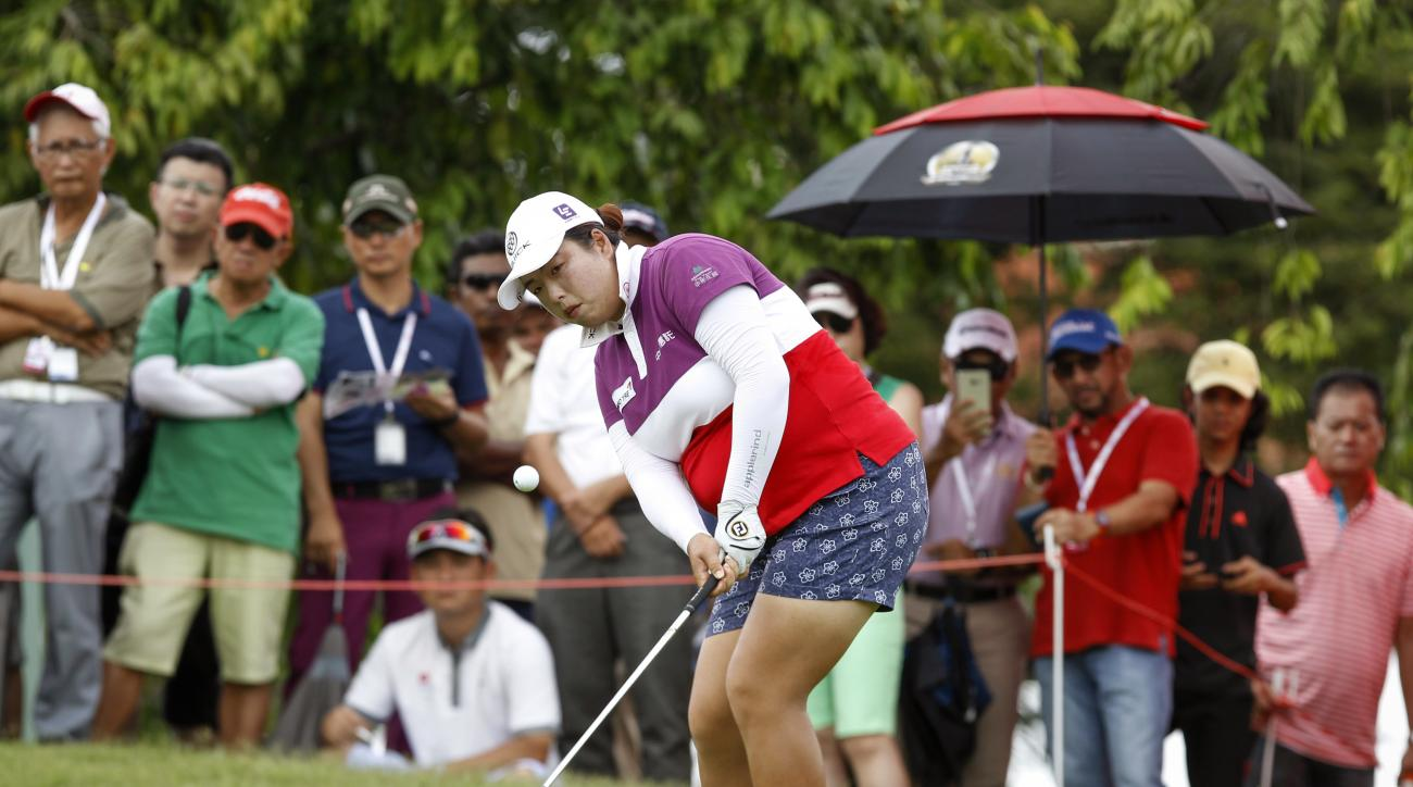 Shanshan Feng of China eyes the ball as she chips on the ninth green during the final round of the LPGA golf tournament at Tournament Players Club (TPC) in Kuala Lumpur, Malaysia, Sunday, Oct. 30, 2016. (AP Photo/Joshua