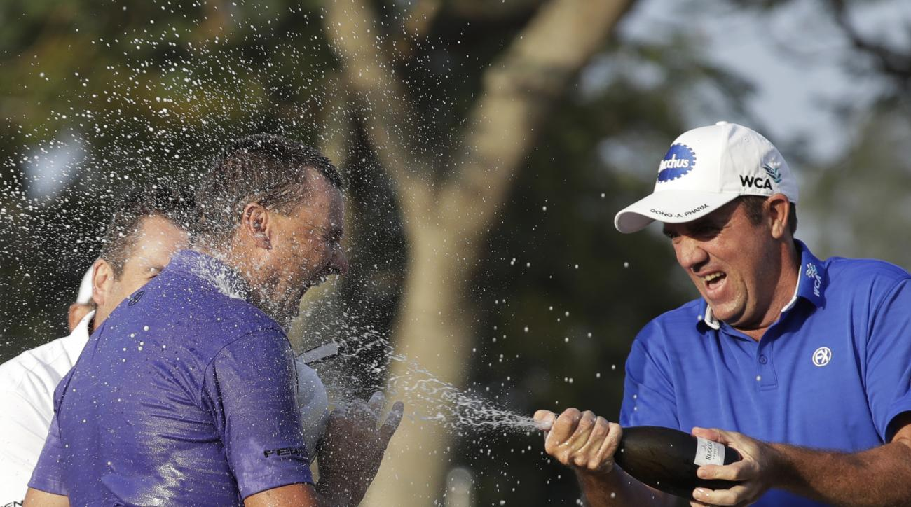 Australia's Sam Brazel, left, celebrates with his supporter after winning the Hong Kong Open.