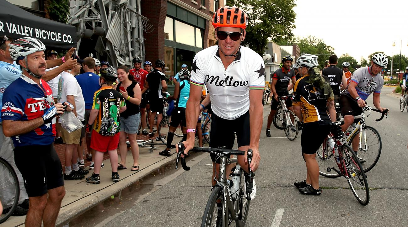 Lance Armstrong departs at the start of the third day of the RAGBRAI en route to West Des Moines last year.