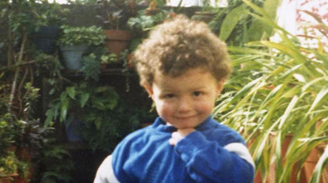 A 23-month old Cristiano Ronaldo smiles for the camera.