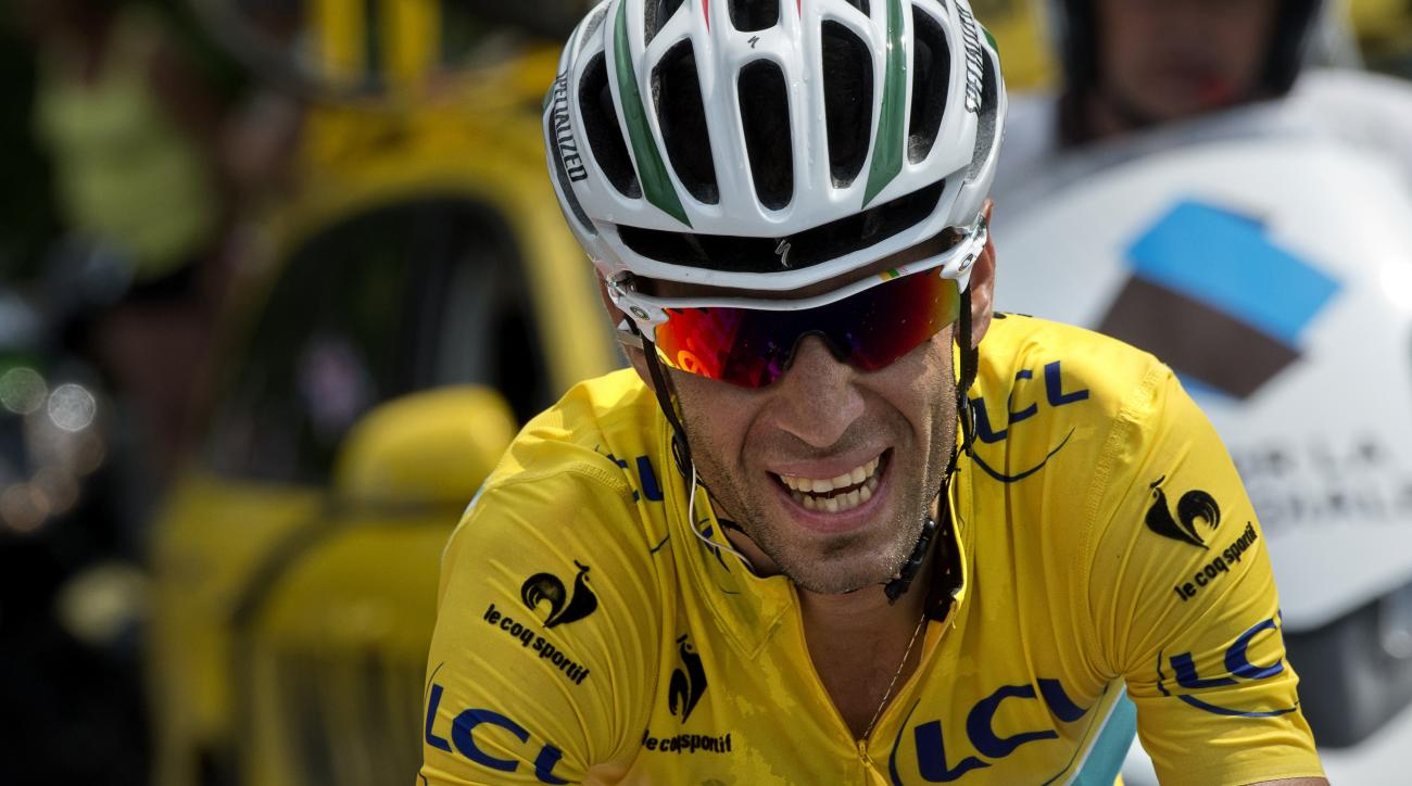 Italy's Vincenzo Nibali wearing the overall leader's yellow jersey rides in a breakaway during the 145.5 km eighteenth stage of the 101st edition of the Tour de France.