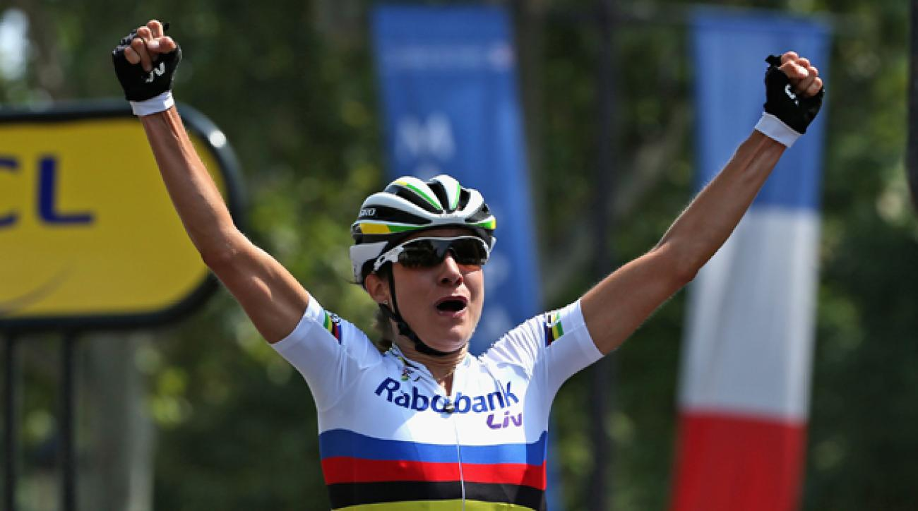 Marianne Vos of the Netherlands celebrates as she crosses the line to claim victory in La Course by Le Tour de France.