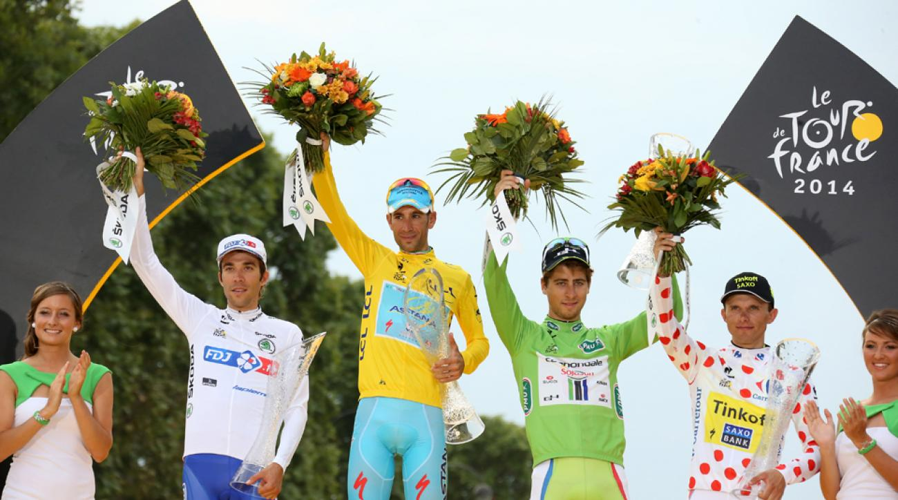 Thibaut Pinot of France, winner of the Tour Vincenzo Nibali of Italy, Peter Sagan of Slovakia, and Rafal Majka of Poland pose on the podium after the twenty one and last stage of the 2014 Tour de France.