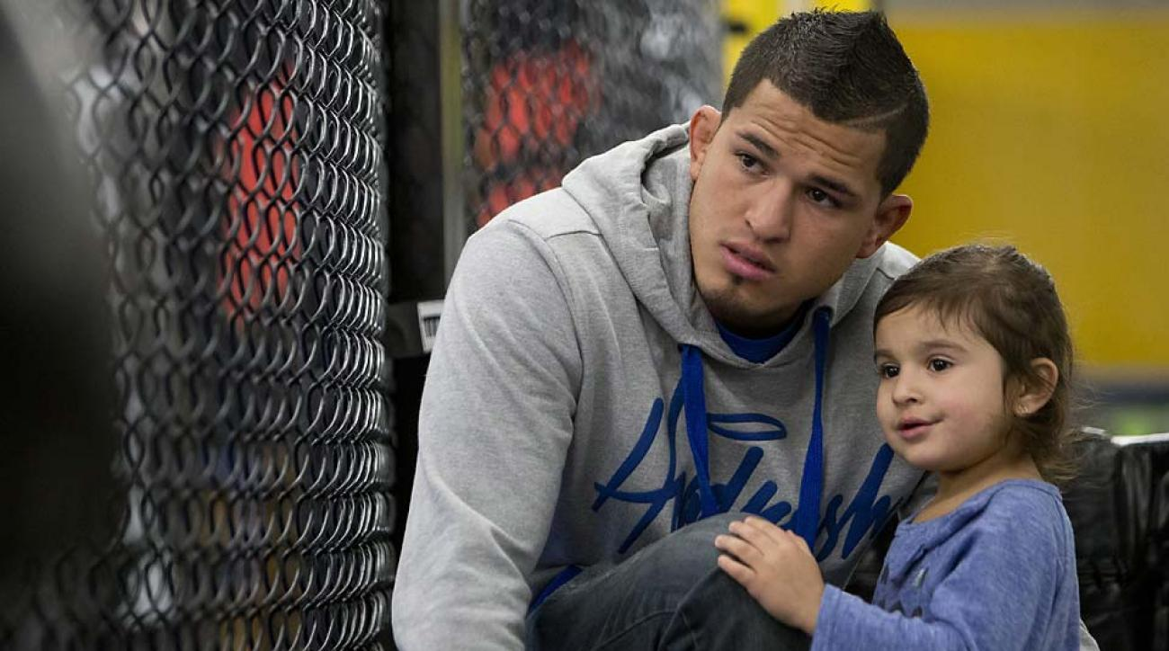 Anthony Pettis, pictured here with daughter Aria, is the UFC's reigning lightweight champ.