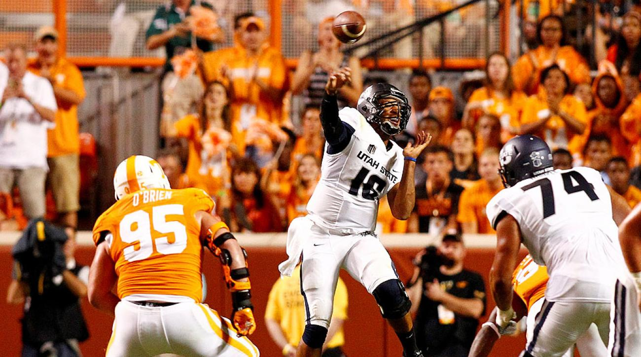 Chuckie Keeton (16) looked rusty against Tennessee after the Utah State QB missed part of the 2013 season with a torn ACL.