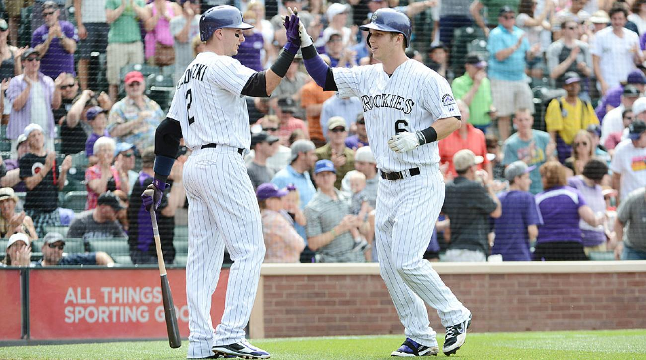 Outfielder Corey Dickerson (right) has been invaluable to the Colorado Rockies with a hit in all but three starts in June.