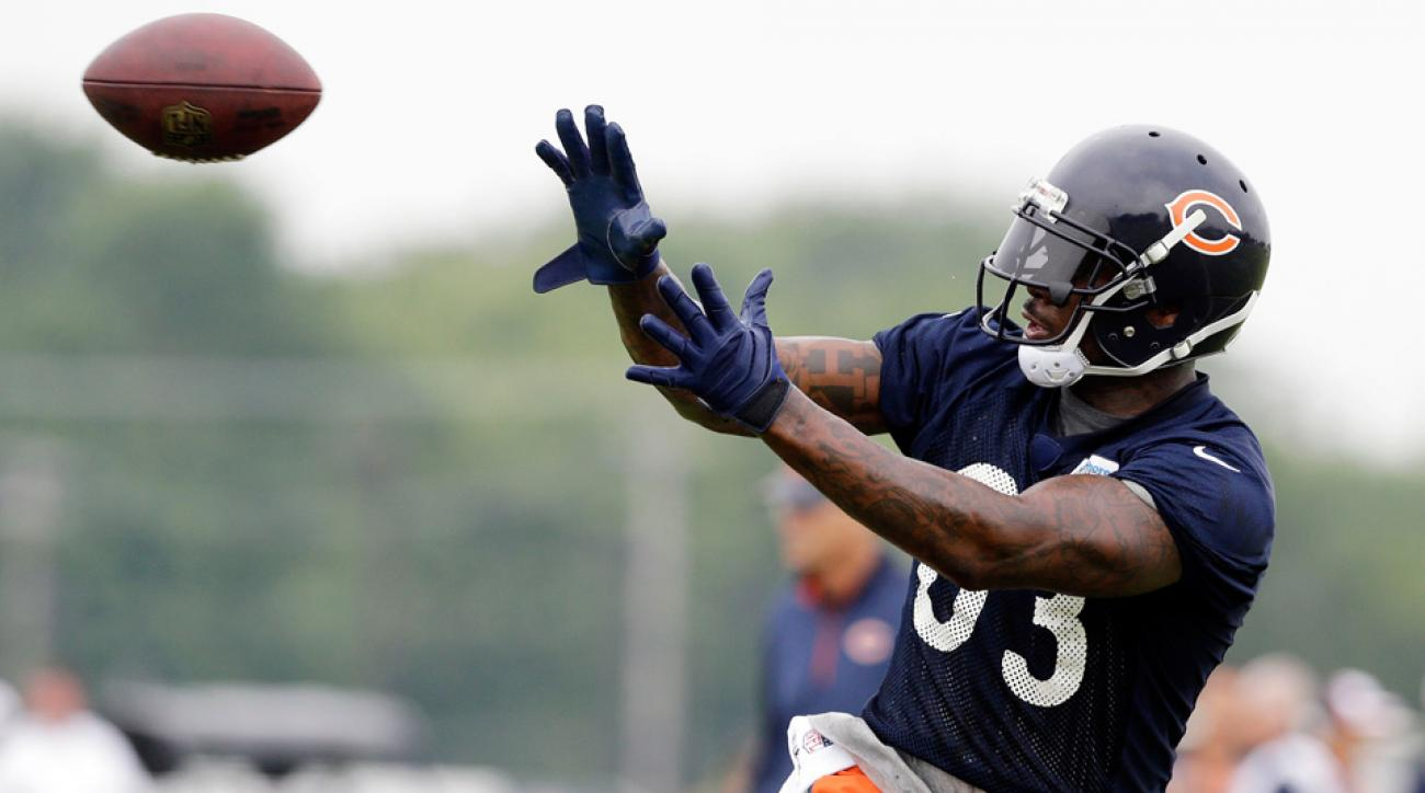 Chicago Bears tight end Martellus Bennett catches a ball during the team's NFL football training camp on Saturday, July 26, 2014, in Bourbonnais, Ill.