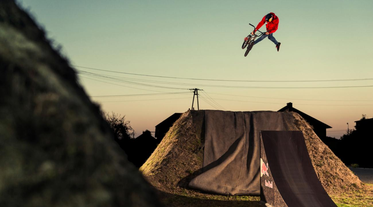 Dawid Godziek performing a 360 on his BMX bike at a course in Suszec, Poland.