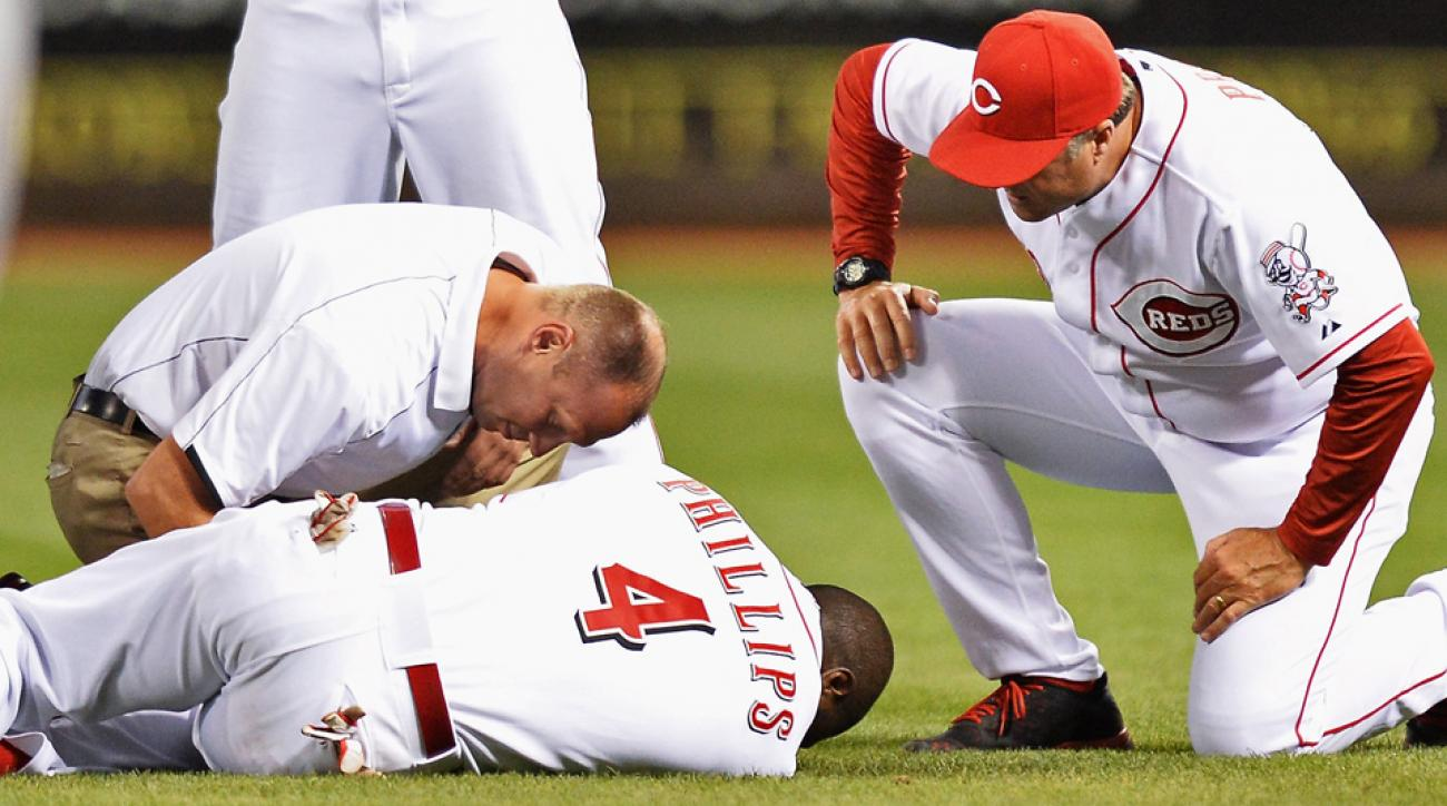 Brandon Phillips hurt his thumb diving for a groundball on Wednesday and will miss at least the next six weeks after undergoing surgery on Thursday.