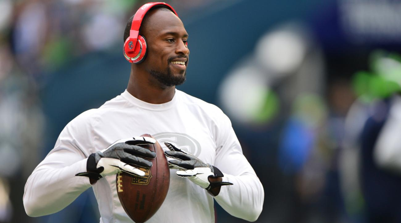 Vernon Davis practices on the field before a game against the Seattle Seahawks at CenturyLink Field.