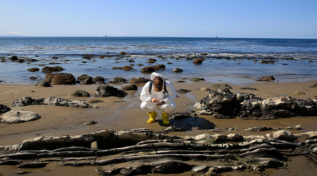 UCSB Marine Science Institute graduate student Nicholas Schooler (CQ) conducts natural resource damage assessments in the aftermath of the oil spill on the May 22, 2015 along the Gaviota coast, in Santa Barbara, California.