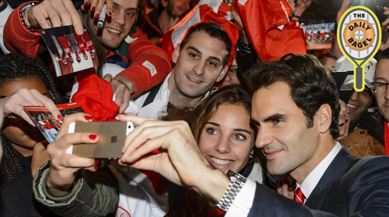 Federer poses for a selfie with a fan during the Swiss team's trip to Lausanne.
