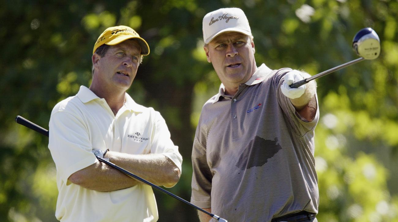 From left to right, Fred Funk and Hal Sutton talk on the seventh hole during the final round of the 85th PGA Championship at Oak Hill Country Club on August 17, 2003 in Rochester, New York.