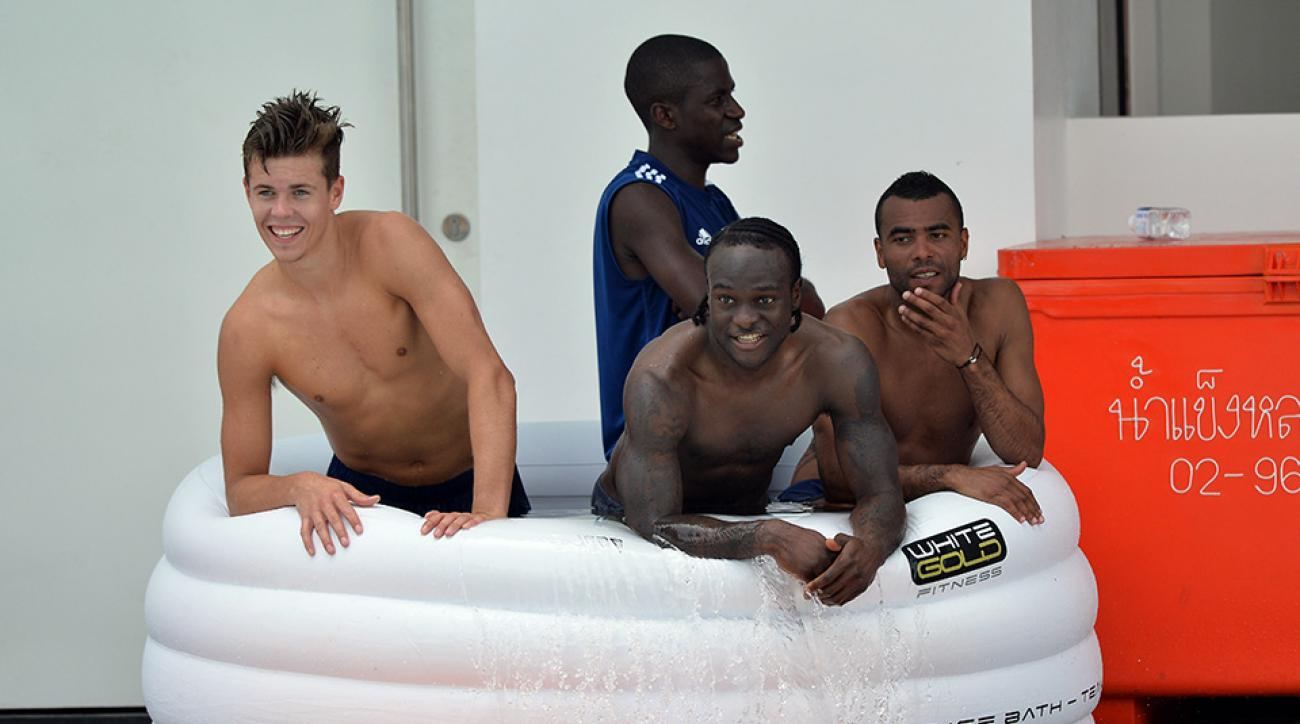 Chelsea's Marco Van Ginkel, Ramires, Victor Moses, Ashley Cole in the ice bath after a training session at the International School of Bangkok in Thailand.