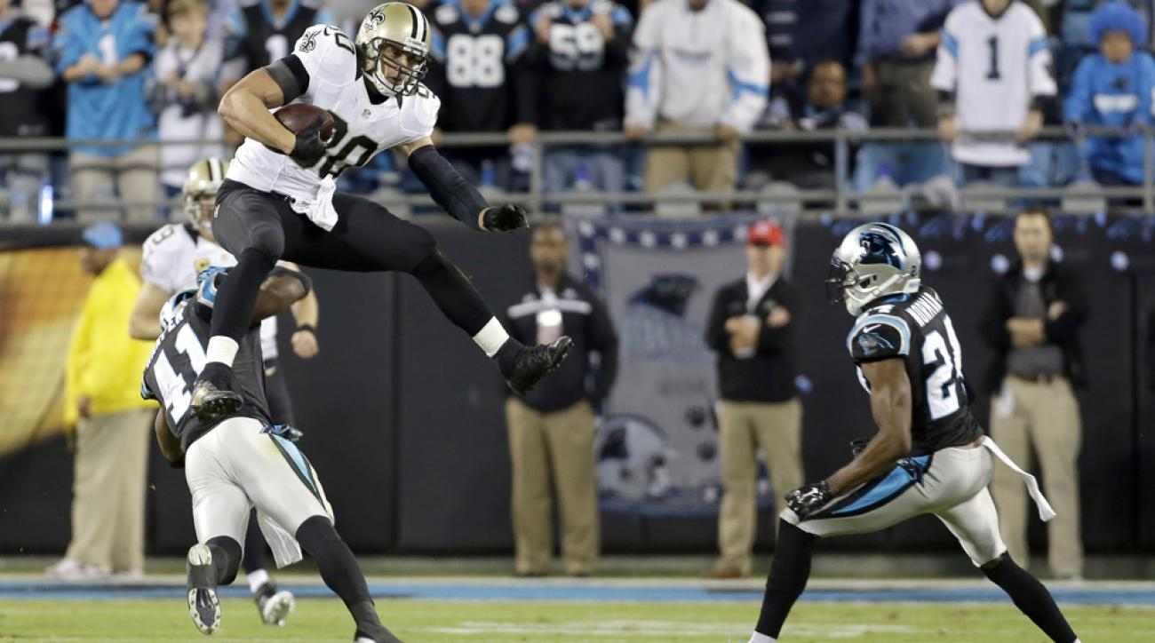 Graham leaps over Carolina Panthers' Roman Harper.