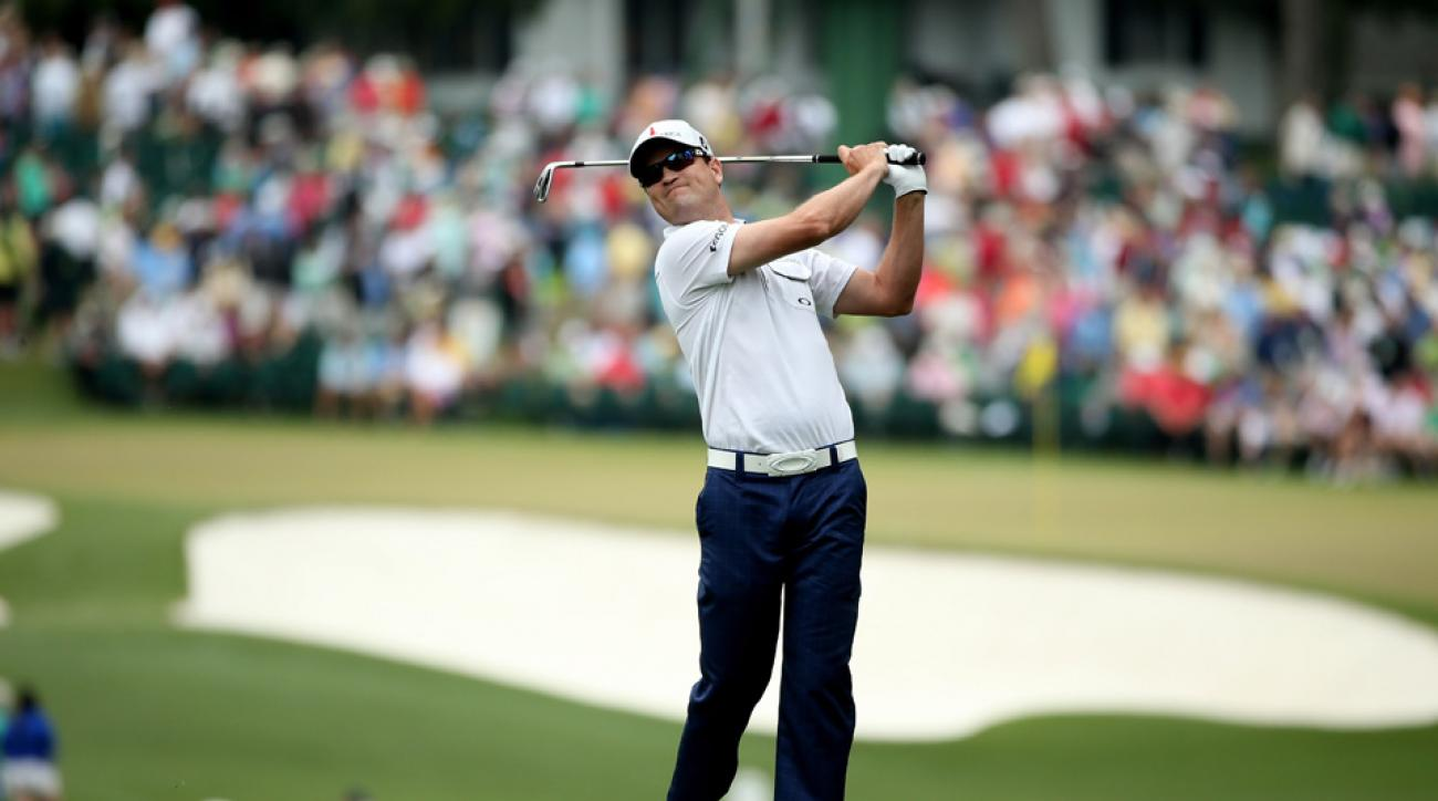 Zach Johnson hits his second shot on the first hole during the final round of the 2013 Masters Tournament at Augusta National Golf Club.