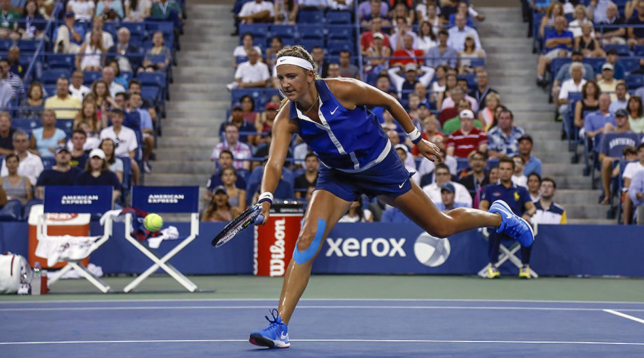 Victoria Azarenka, seen wearing KT Tape, returns the ball during the Women's Singles fourth round match at the 2014 US Open.