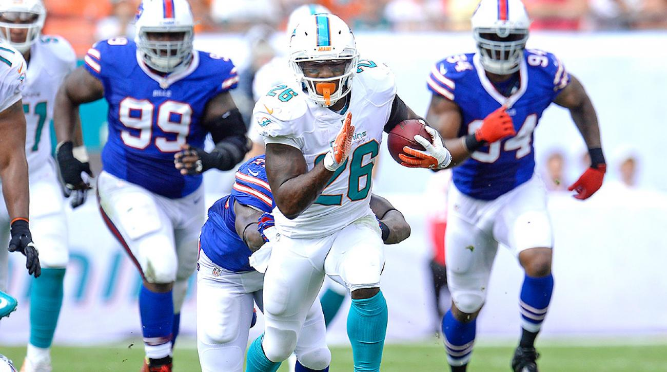 Lamar Miller, who rushed for 709 yards and two touchdowns last season, will compete with Knowshon Moreno for the starting RB job in Miami.