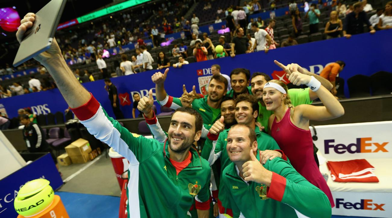 Marin Cilic takes a group selfie after teammate Kristina Mladenovic of the UAE Royals defeated Kirsten Flipkens of the Manila Mavericks at the IPTL in Singapore.
