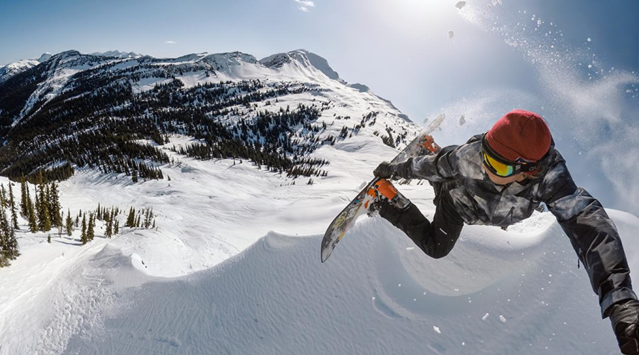 Matt Cook follows snowboarder Travis Rice (pictured) down the mountain.